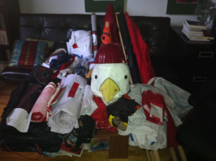 27 banners and 1 puppet sit in my living room, waiting to be put on display at the Masses & Médias 2013 event.