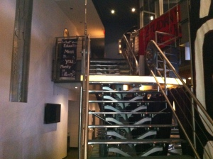 Banner exhibit up the stairs in main lobby of Cinéma Excentris.