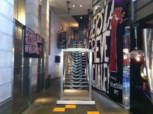 View of the banner exhibit in the hallway leading to the stairs in the lobby of Cinéma Excentris.