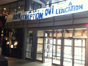 """Non à la corruption. Oui à l'éducation"" is hung from bannisters above the main entrance at Cinéma Excentris."