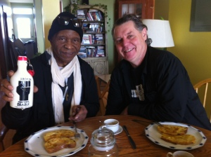 Angola 3 member, Robert Hillary King (with syrup bottle in hand) and Ron Harpell (director of Hard Time) have a French toast breakfast in Montréal, 22 Feb 2014)